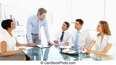 Businessman speaking to his staff during meeting in the...