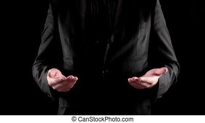businessman speaks on black