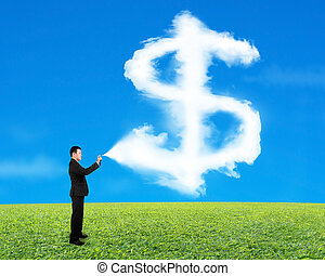 Businessman spraying dollar sign shape cloud paint with sky gras