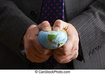 Businessman Squeezing Globe Over North America