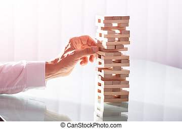 Businessman Stacking Wooden Blocks