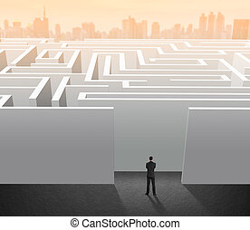 Businessman stand in maze, problem and solution