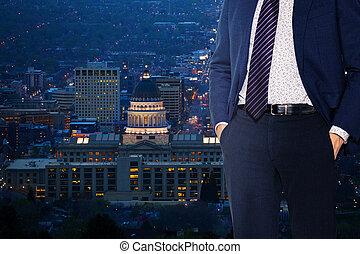 Businessman stand near window in Salt Lake City
