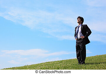 businessman stand on the meadow