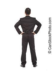 businessman standing and put hand on waist.
