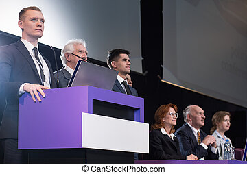 Businessman standing at podium