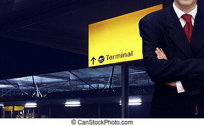 Businessman standing at the airport terminal