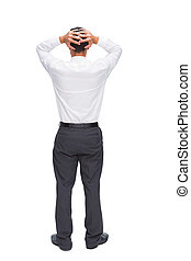 Businessman standing back to camera hands on head