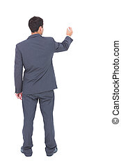 Businessman standing back to camera