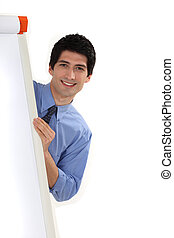 businessman standing behind a white board