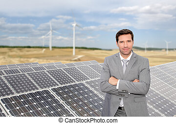 Businessman standing by photovoltaic installation