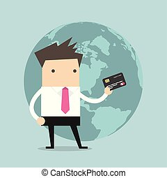 Businessman standing holding his a credit card in front of the globe.