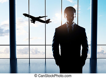 businessman standing in airport