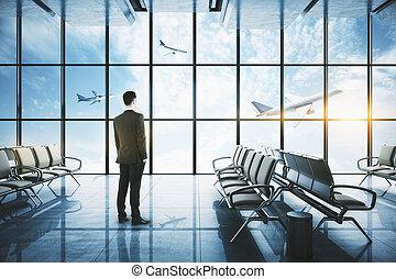 Businessman standing in airport interior