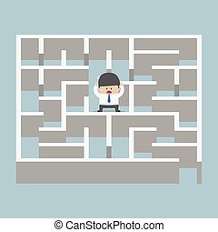 Businessman standing in center of the maze