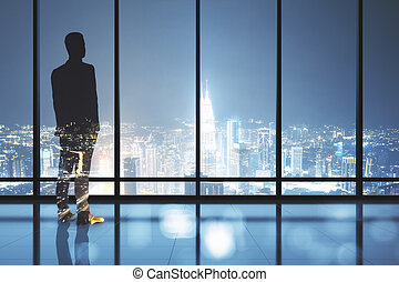 Businessman standing in contemporary office