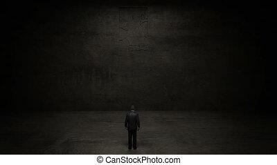 businessman Standing in front of a open door sign.