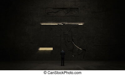 businessman standing in front of black wall, shape of a Yuan sign.Yuan currency.Yuan money.