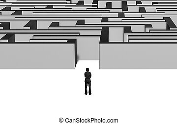 Businessman standing in front of maze