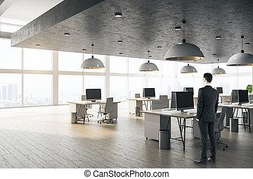 Businessman standing in modern office interior