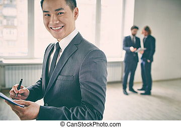 Businessman standing isolated