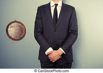 Businessman standing next to mirror