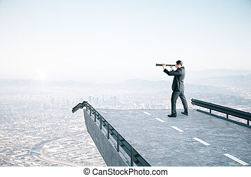 Businessman standing on a destroyed bridge with telescope