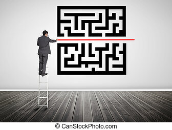 Businessman standing on a ladder drawing red line through qr code in empty room