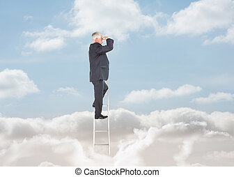 Businessman standing on a ladder over clouds