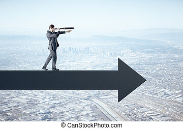 Businessman standing on abstract arrow