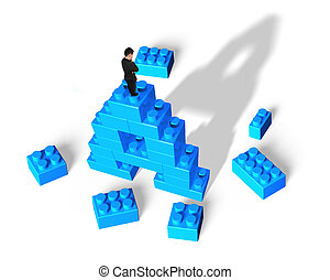 Businessman standing on alphabet letter A shape stack blocks