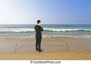 businessman standing on beach