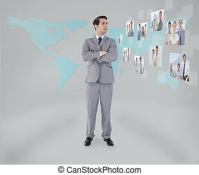 Businessman standing on map background