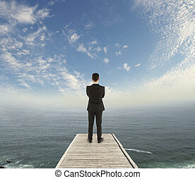 businessman standing on pier