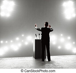businessman standing on podium and closes on outbreaks