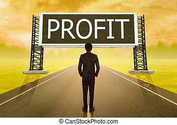 businessman standing on road and looking with large sign of profit
