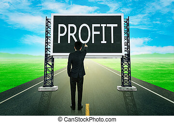 businessman standing on road and pointing with large sign of profit