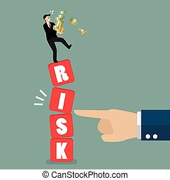 Businessman standing on shaky risk blocks by hand of enemy