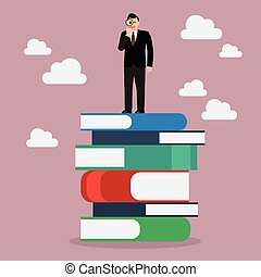 Businessman standing on stack of books with a magnifying glass copy