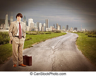 Businessman standing on the road.