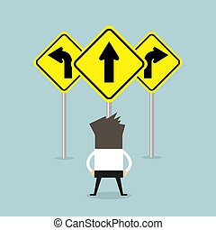 Businessman standing on three way arrows road sign.