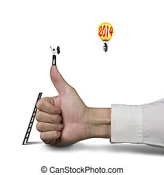 Businessman standing on top of thumb, another in balloon with 2014, white background