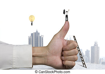 Businessman standing on top of thumb, another in lamp balloon