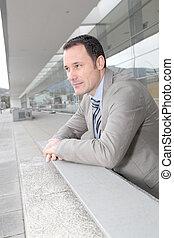 Businessman standing outside congress center