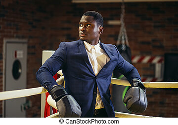 Businessman standing posture in boxing gloves