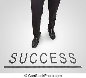 Businessman standing wearing court shoes on success line.