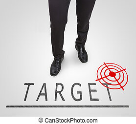 Businessman standing wearing court shoes on target(aim)...