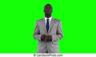 Businessman standing while making an announcement