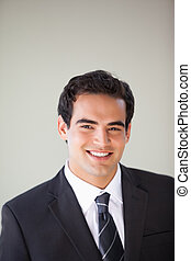 Businessman standing while smiling