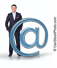 Businessman standing with email at